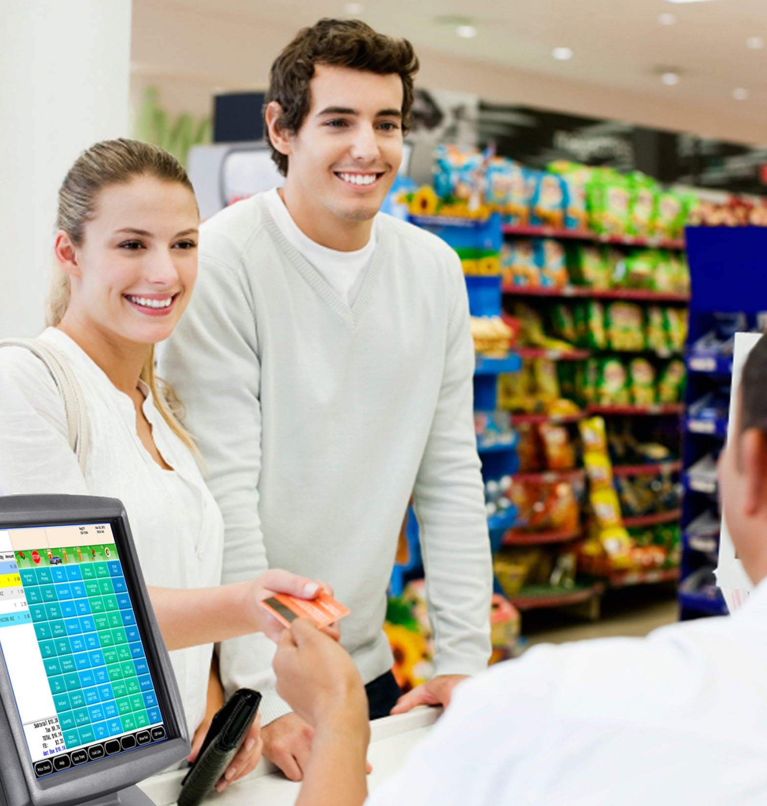 couple paying inside convenience store