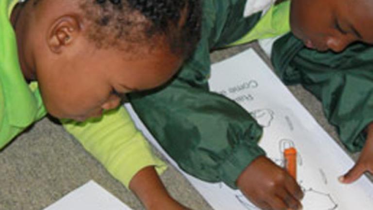 school kids writing a test