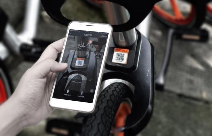 phone scanning a bike code