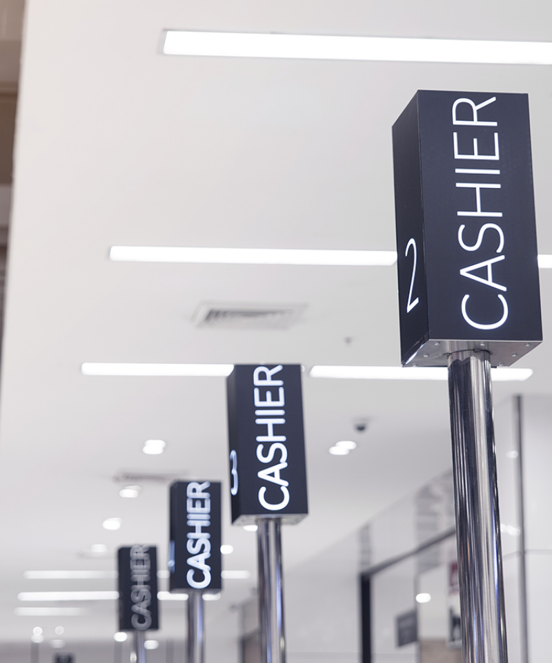 Cashier poles at checkout counter